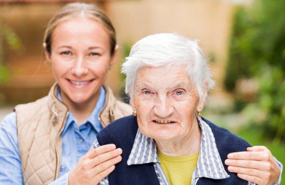 Elderly woman with grandchild